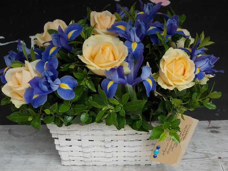 flowers in white baskets