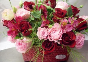 red and pink rose basket