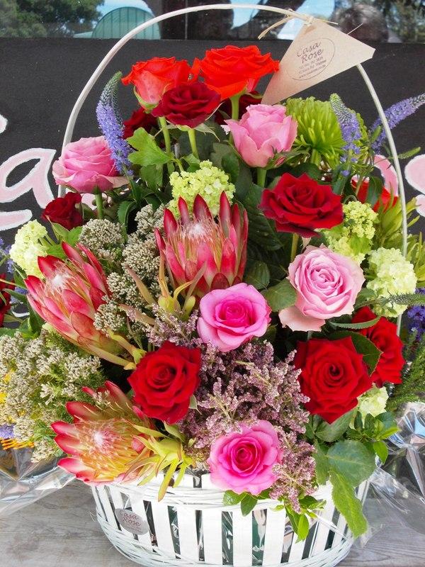 Picket fence basket of flowers