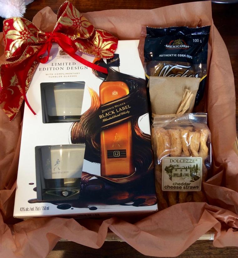 Hamper of snacks and Johnny Walker black label or Jack Daniels presentation pack. R750.