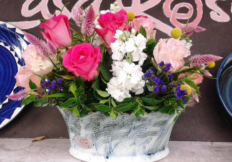 Flower arrangement in oval ceramic bowl