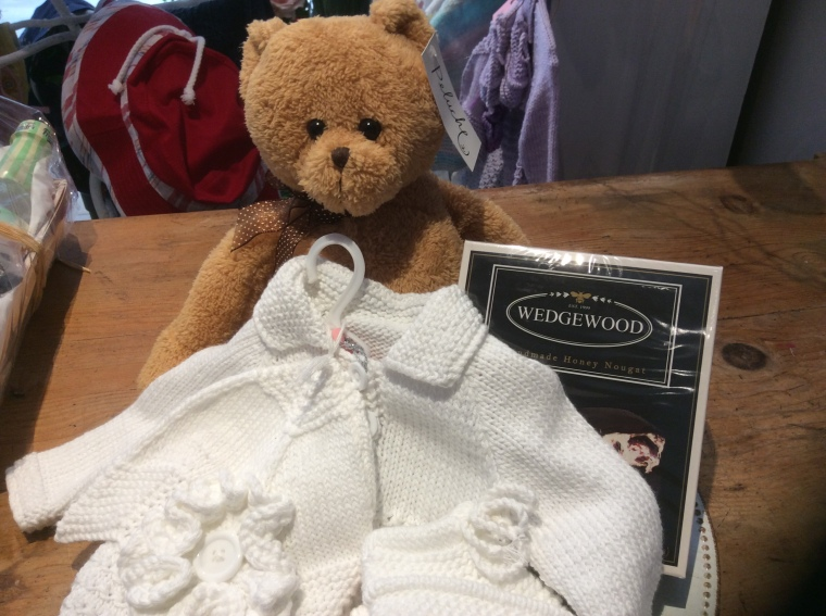 Baby hamper, knitwear, teddy and chocolate nougat.