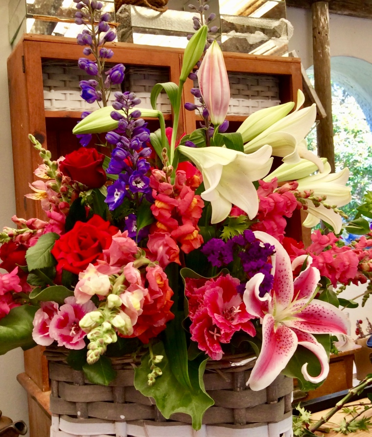 Large basket of mixed flowers