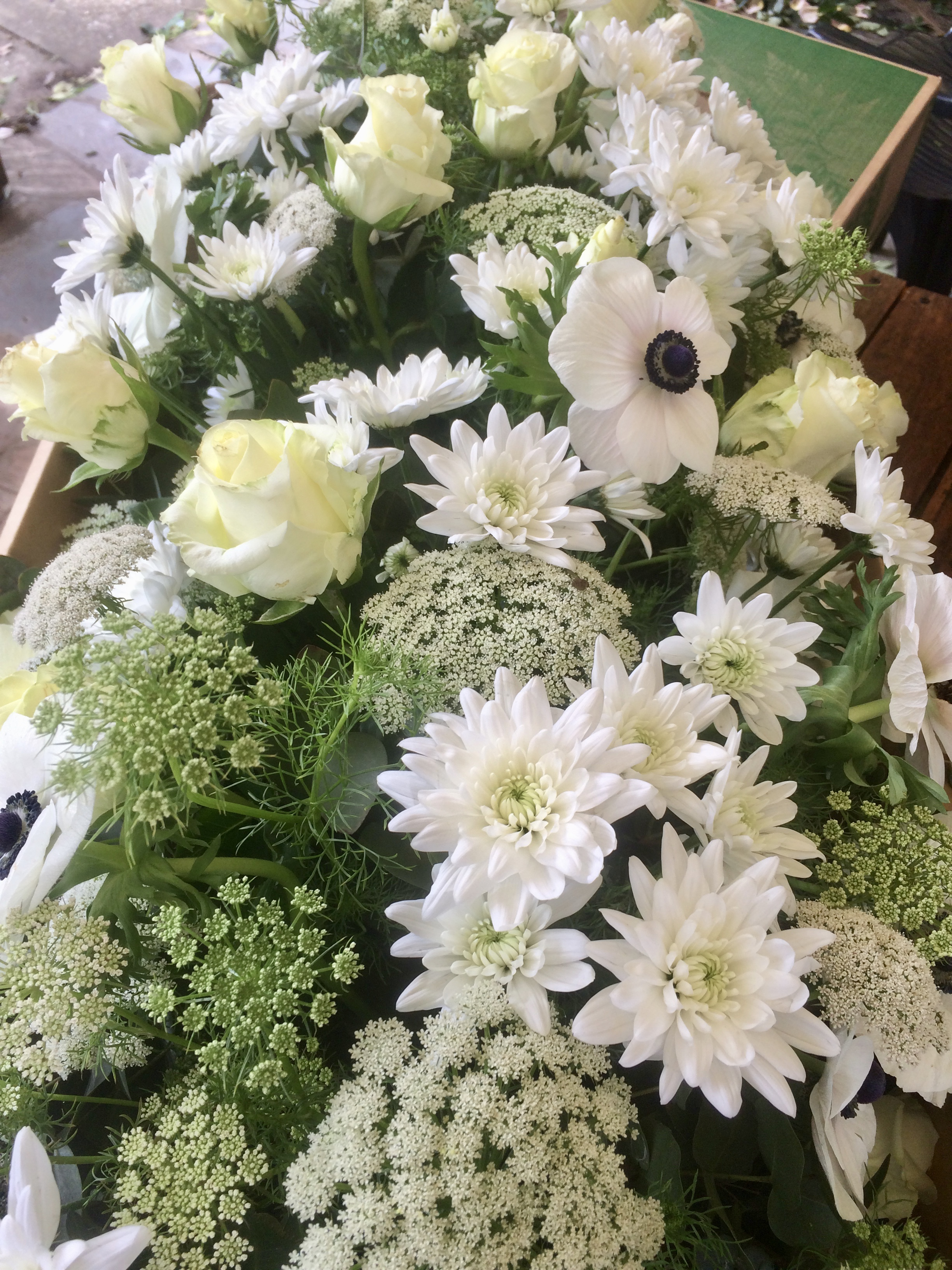 Mixed white and green flower casket spray.