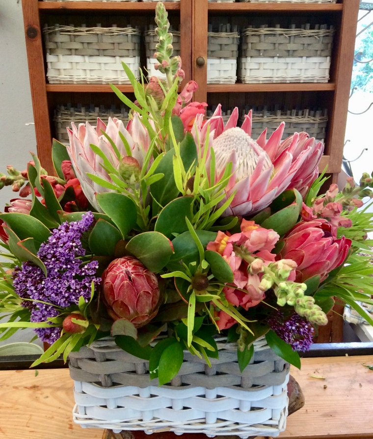 Mixed floral arrangement with proteas.